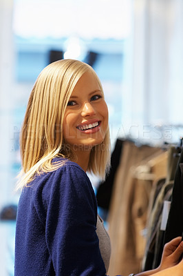 Buy stock photo Portrait of happy young woman selecting clothes in shop