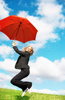 Buy stock photo Portrait of business woman jumping in joy with umbrella