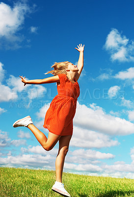 Buy stock photo Full length of young girl jumps for joy in green field