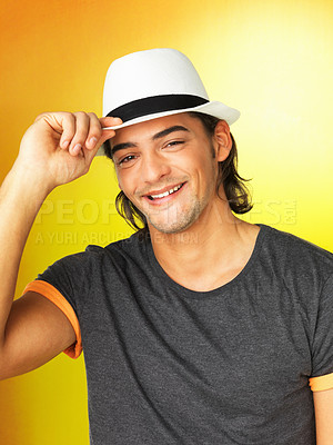 Buy stock photo Happy man against yellow background holding brim of hat