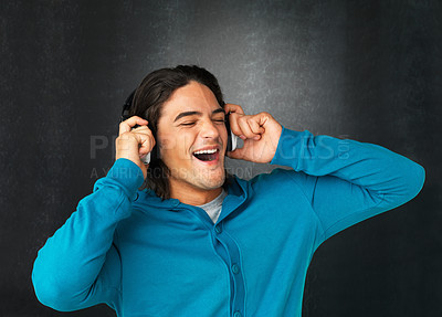Buy stock photo Man singing while listening to headphones against gray background