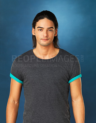 Buy stock photo View of attractive man standing against blue background