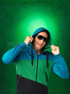 Buy stock photo Attractive man with sunglasses pulling on hood of sweatshirt