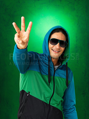 Buy stock photo Handsome man in sunglasses and jacket holding up three fingers