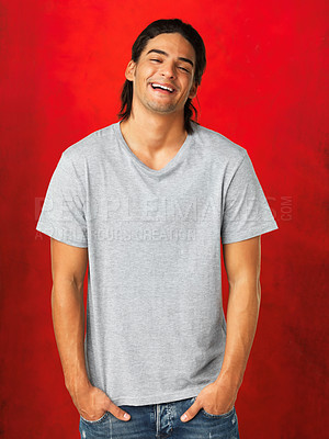Buy stock photo Man standing and smiling against red background