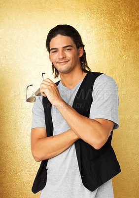 Buy stock photo Attractive man holding sunglasses and smiling
