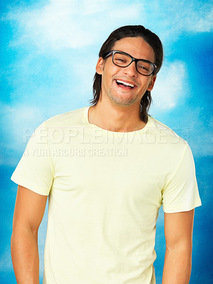 Buy stock photo Cheerful man in glasses on blue background