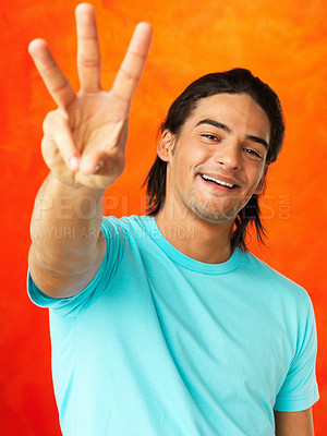 Buy stock photo Handsome young man holding up three fingers