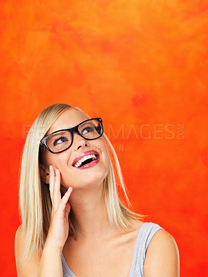 Buy stock photo Closeup of pretty woman in glasses looking up at copyspace