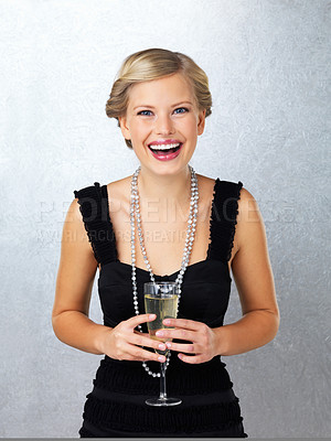 Buy stock photo Happy young woman holding champagne flute
