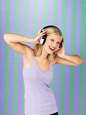 Buy stock photo Beautiful woman singing while listening to headphones