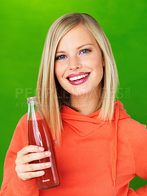 Buy stock photo Closeup of pretty woman holding cola bottle on green background
