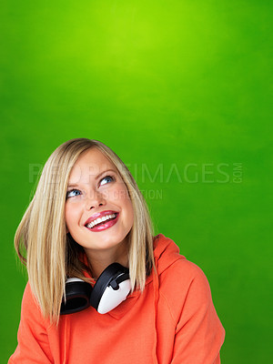 Buy stock photo Closeup of pretty blond with headphones looking up at copyspace