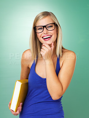 Buy stock photo Attractive woman in sunglasses smiling while holding book
