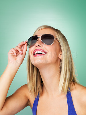 Buy stock photo Woman adjusting her sunglasses while looking up