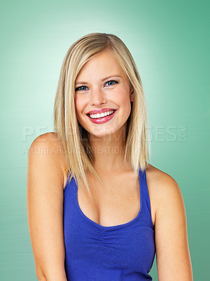 Buy stock photo Portrait of beautiful young girl smiling on green background