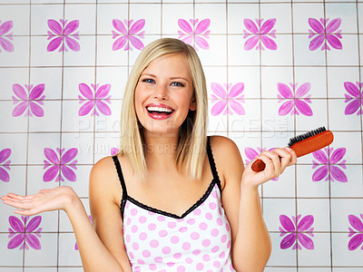 Buy stock photo Pretty blonde smiling while holding brush