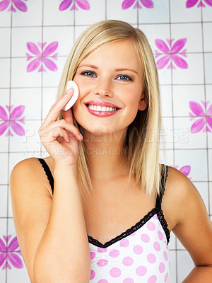 Buy stock photo Attractive blonde woman applying make up indoors