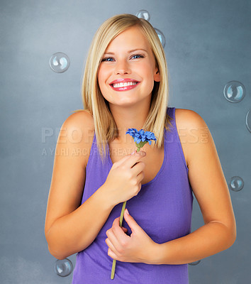 Buy stock photo Pretty woman smiling while holding flower