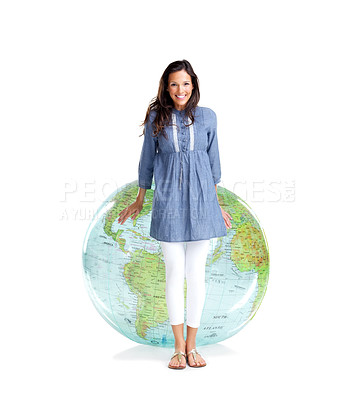 Buy stock photo Portrait of a pretty young woman standing beside a globe against white background