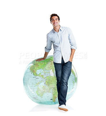 Buy stock photo Portrait of a handsome young guy standing near globe on white background