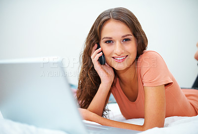 Buy stock photo Portrait of girl on bed with laptop while listening to phone
