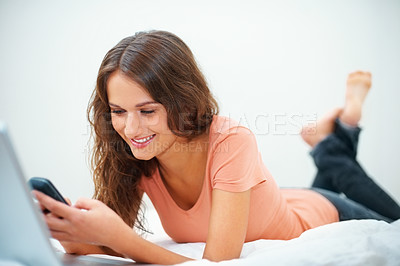 Buy stock photo Happy girl trying to call her friend on her cell phone