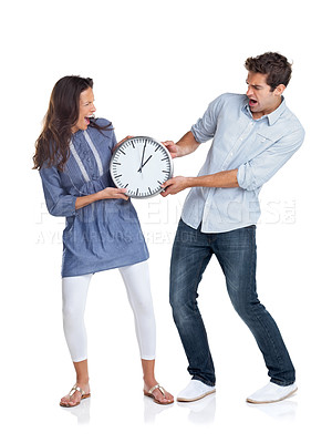 Buy stock photo Portrait of an angry young couple having an argument on a clock against white background