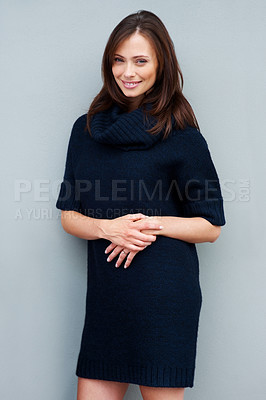 Buy stock photo Portrait of a charming young female fashion model smiling against grey background