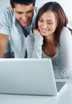 Buy stock photo Portarit of a happy young couple working together on laptop