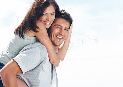 Buy stock photo Portrait of a beautiful young couple in playful mood against bright background