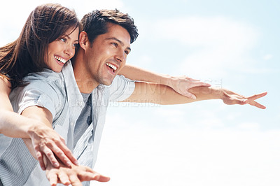 Buy stock photo Portrait of an attractive young couple enjoying their summer holiday - Outdoor