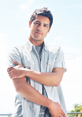 Buy stock photo Portrait of an attractive young guy looking at you with an attitude - Outdoor
