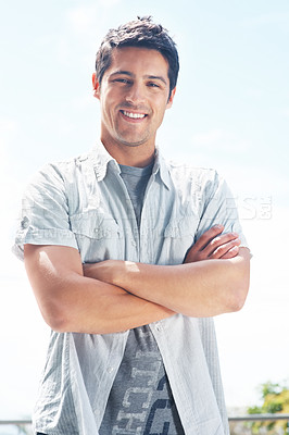 Buy stock photo Portrait of a happy young man standing with folded hands - Outdoor