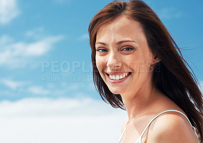 Buy stock photo Portrait of a gorgeous young lady smiling against the sky - Outdoor