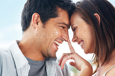 Buy stock photo Closeup portrait of a smiling young couple standing head to head - Outdoor