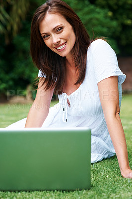 Buy stock photo Portrait of beautiful young woman sitting with laptop in the park - Outdoor