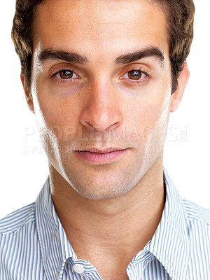 Buy stock photo Closeup portrait of a young man looking serious against white background