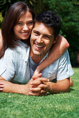 Buy stock photo Portrait of a beautiful young couple playing together on grass in the park - Outdoor