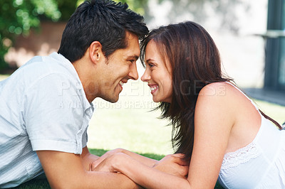 Buy stock photo Portrait of a happy young couple looking at each other - Outdoor