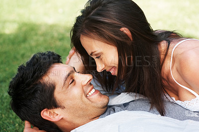 Buy stock photo Closeup portrait of a romantic young couple enjoying some fun outdoors on a sunny day