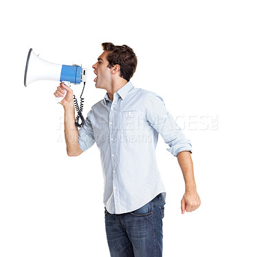 Buy stock photo Profile image of a handsome young man yelling into a megaphone against white background