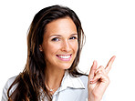 Happy young business woman pointing at copyspace