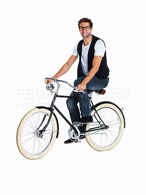 Buy stock photo Handsome casual man riding bicycle