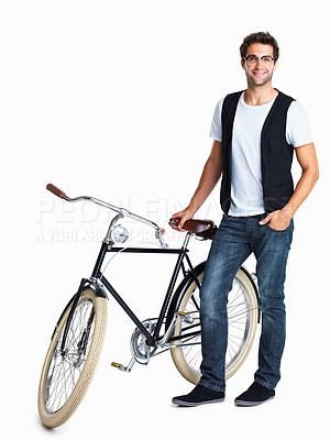Buy stock photo Casual man standing next to a retro bike and smiling - isolated on white
