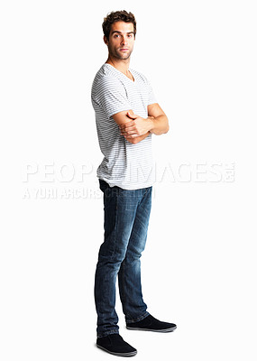Buy stock photo Handsome man standing with arms crossed and looking aloof