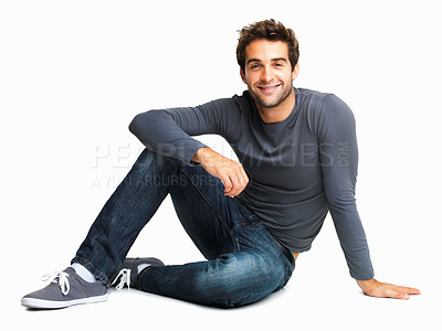 Buy stock photo Smiling man casually sitting on the floor