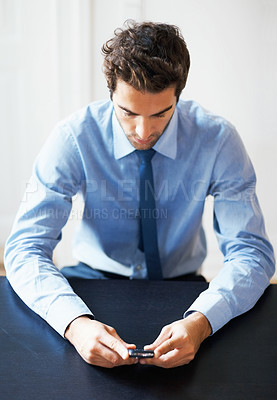 Buy stock photo Portrait of young executive holding cell phone in the office