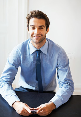 Buy stock photo Portrait of happy young business man with mobile phone in board room