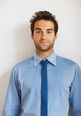 Buy stock photo Portrait of handsome business man standing against colored background